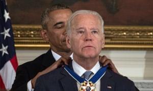 Barack Obama awards Joe Biden the presidential medal of freedom at the White House in Washington DC on 12 January 2017.