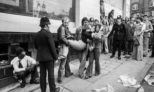 An injured protester is helped to safety in Clifton Rise, New Cross