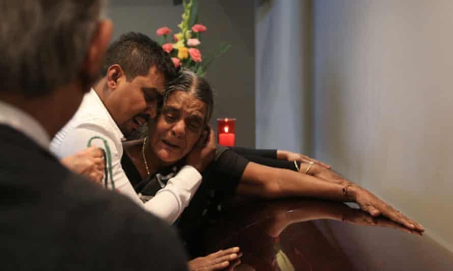 Santhanaladchumy Kanagaratnam the mother of Kirushnakumar Kanagaratnam, weeps beside her son's coffin.