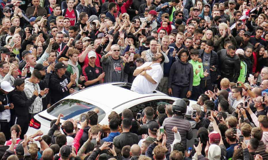 Nouri's father, Mohamed, acknowledges the crowd that had gathered outside the family home in Geuzenveld.
