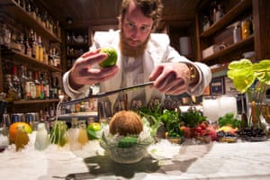 Bartender Thomas Waugh prepares a coconut cocktail at ZZ's in New York