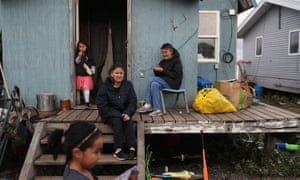 """Lizzy Hawley, center, and her sister Ella Hawley, right, live in Kivalina, Alaska. An estimated one in three Native people live in what the Census Bureau considers """"hard-to-count"""" areas."""