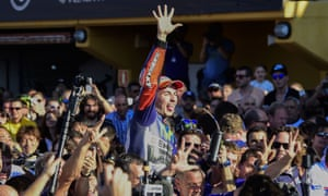 Jorge Lorenzo celebrates with the Spanish fans at the Valencia GP, where he made up a seven-point lead to pip Valentino Rossi to the MotoGP championship.
