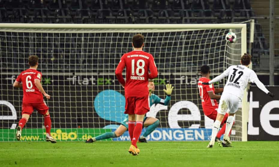 Florian Neuhaus scores the winning goal, having earlier conceded a penalty for Robert Lewandowksi's opener.