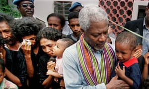Former UN secretary-general comforts a crying child among a group of survivors of the Liquica massacre in East Timor in 1999.