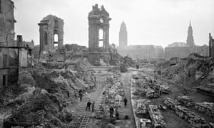 The German city of Dresden photographed in 1952, as workers remove bomb debris in front of the ruins of the Frauenkirche.