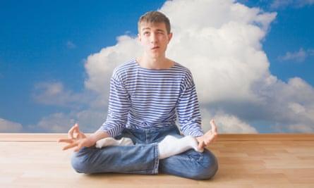 Teenage boy making a face in the lotus pose