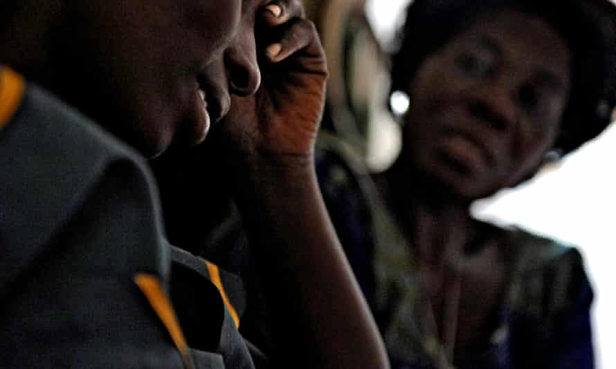 A rape victim in the Democratic Republic of Congo talks to a counsellor. High rates of sexual violence in the country means that online abuse is not taken seriously.