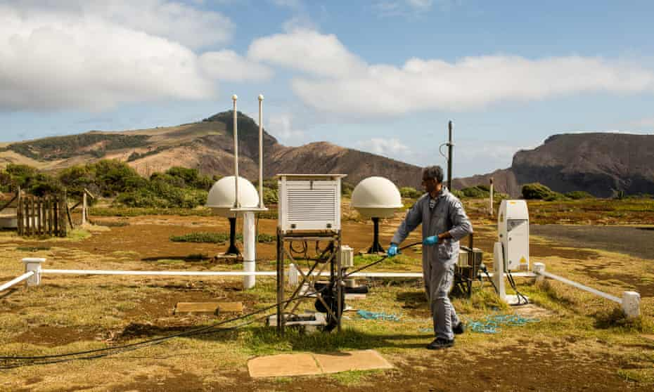 Marcos Henry, adjusting a cable in the meteorological station's 'weather garden'