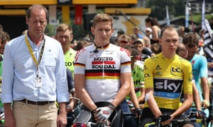 Britain's Chris Froome, wearing the overall leader's yellow jersey, observes a minute of silence in Megeve at start of the 20th stage of the Tour de France