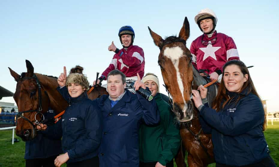 Gordon Elliott and his stable staff celebrate with the Lexus winner Outlander and second-placed Don Poli