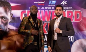 Khan with WBO welterweight title-holder Terence Crawford who he meets at Madison Square Garden on 20 April.