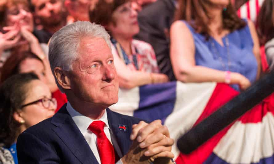 Bill Clinton watching his wife at a rally in June