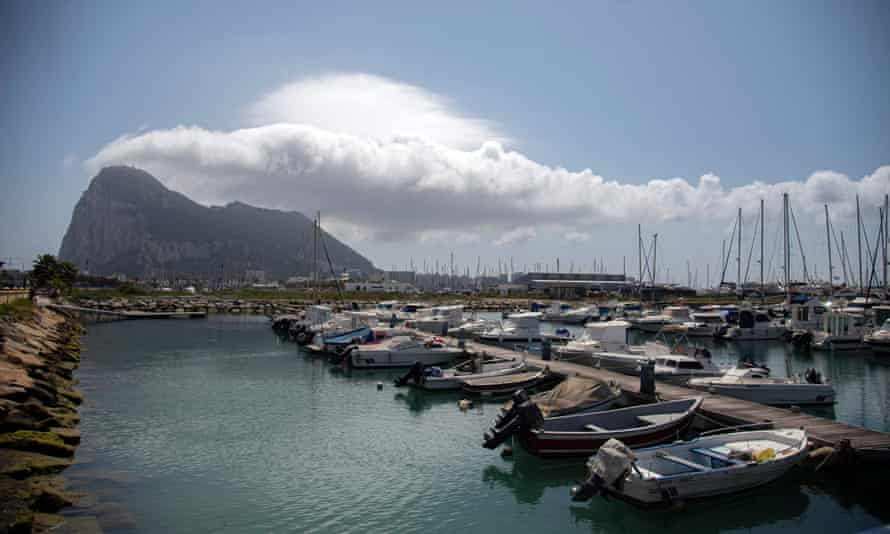 The Rock is pictured in Gibraltar with boats in the foreground