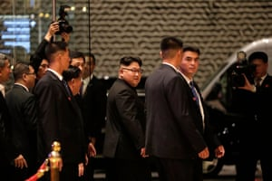 The North Korean leader, Kim Jong-un, walks out from the Marina Bay Sands before a tour of Singapore.