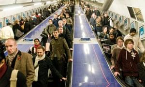People on an escalator on the London underground
