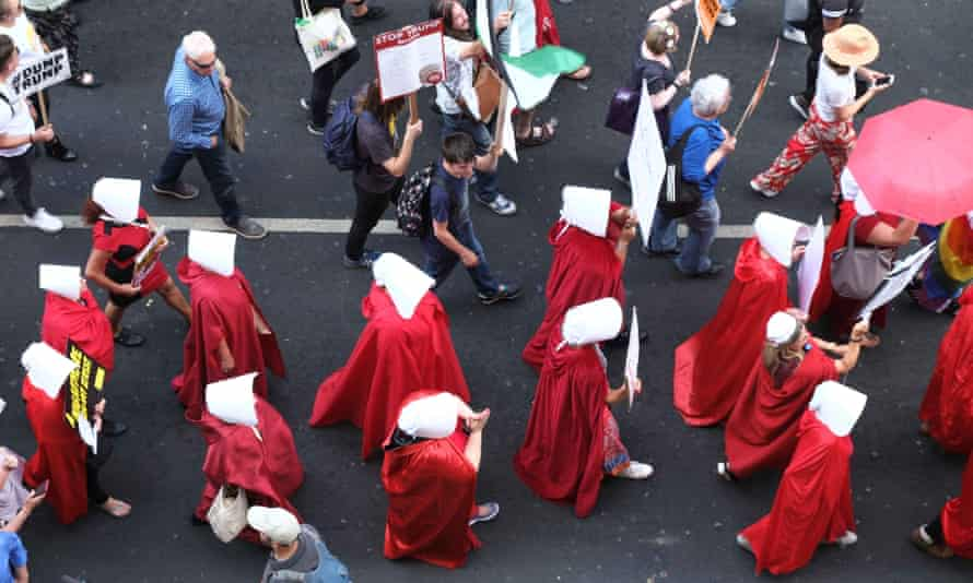 Handmaids on the march during Donald Trump's visit to the UK in July.