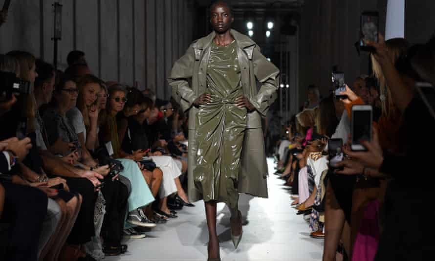 Head-to-toe khaki worn with Naomi-style hands-on-hips swagger.