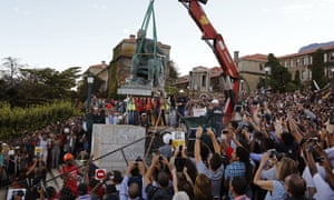 Cheering students surround a statue of British colonialist Cecil Rhodes, as it is removed from the campus at the Cape Town University, South Africa, in 2015.