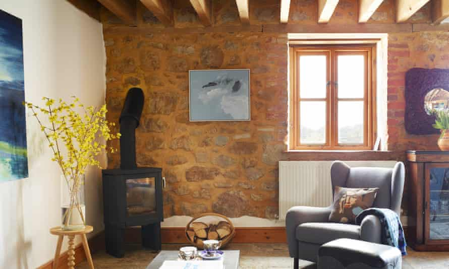 The living room with painting by Catherine Knight.