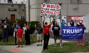 Supporters watch Donald Trump's motorcade arrive for a rally with supporters at High Point University in High Point, North Carolina.
