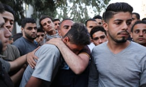 A teenager from Gaza City mourns his brother, killed during protests at the border fence with Israel, May 2018