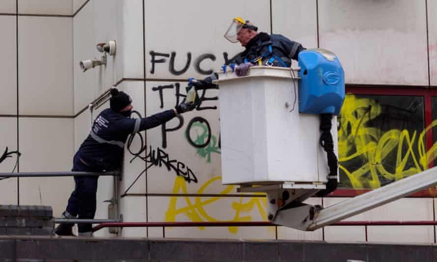 Workers remove graffiti