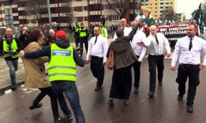 Rightwing Nordic Resistance Movement marchers confronted by leftwing activists in Borlange, Sweden, on 1 May 2016.
