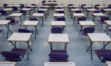 rows of empty desks in an exam hall