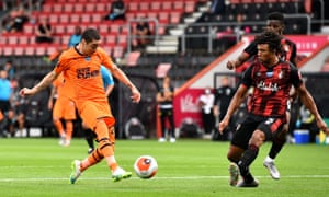 Newcastle's Miguel Almirón strokes home his side's third goal against Bournemouth.