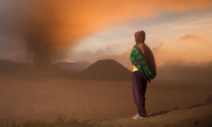 'Our hair is made from volcanic debris' … a member of the Tenggerese people watches the eruption of Mount Bromo in Java in 2011