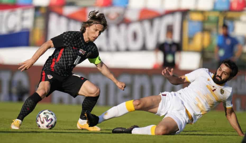 Croatia's Luka Modric evades a challenge by Armenia's Artak Grigoryan during their friendly earlier this month.