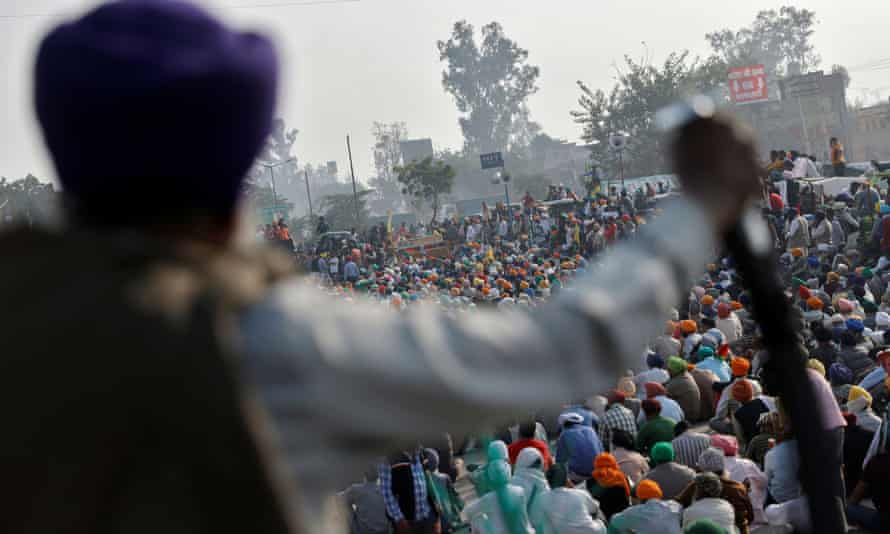 Farmers attend a protest against the newly passed farm bills at Singhu border near Delhi