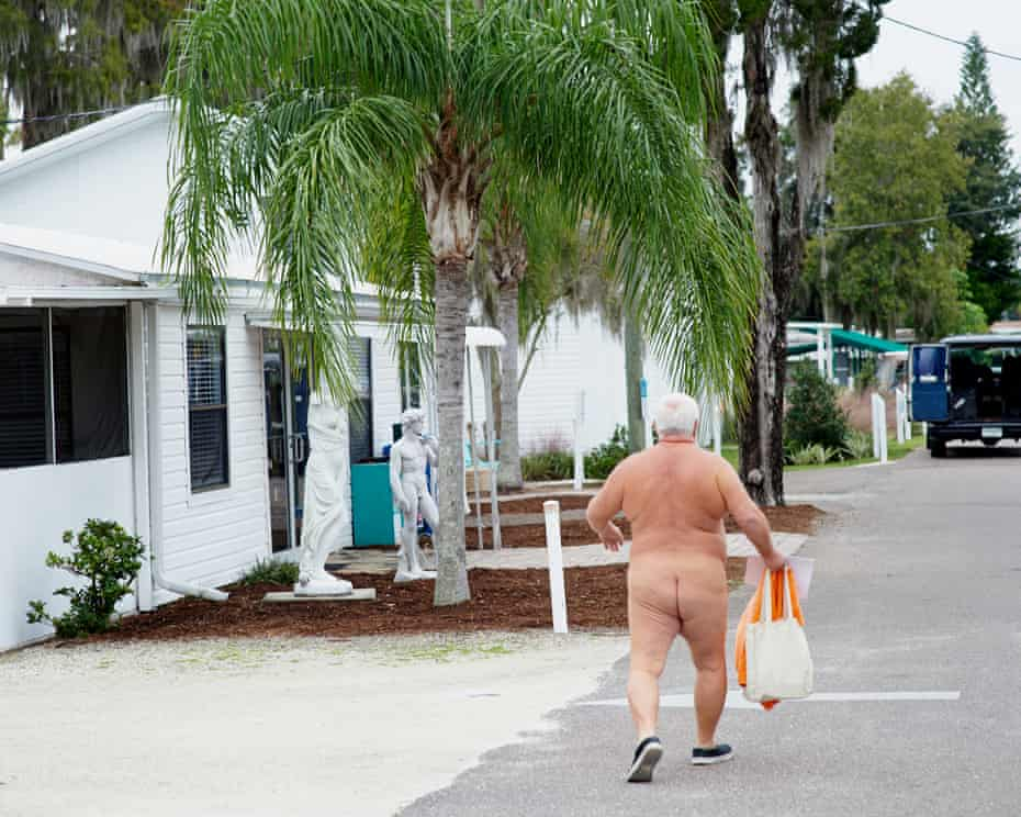 George Lane, a lifelong nudist from Indianapolis, leaves Sunday church service at Lake Como.