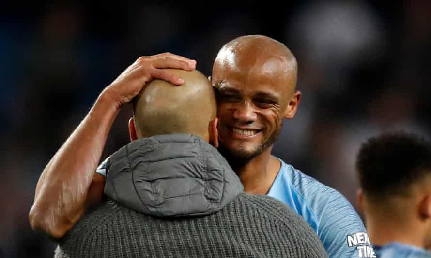 Pep Guardiola and Vincent Kompany embrace after the match.