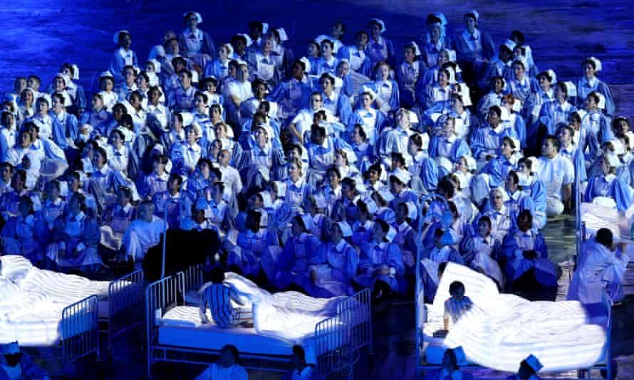 Olympic performers and volunteers dressed as NHS nurses.