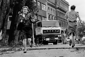 Women run for their lives across 'Sniper Alley' under the sights of Serb gunmen during the siege of Sarajevo