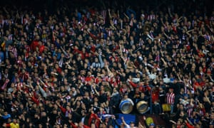 The Atlético fans cheer on their team.