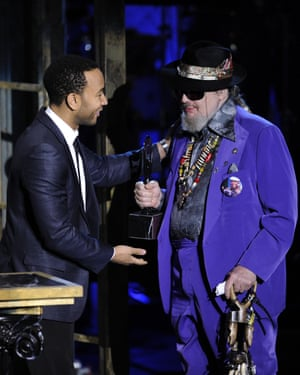 Dr John receives his trophy from John Legend at the Rock and Roll Hall of Fame induction ceremony in New York, in 2011.