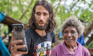 Behrouz Boochani takes a selfie with one of the locals on Manus Island