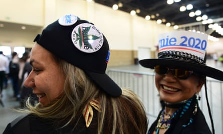 Bernie Sanders backers show their support on their headgear at a rally at the Pasadena Convention Center in Pasadena, California on Friday.