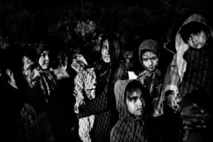 Afghan refugees wait to be registered at the Moria camp on Lesbos.