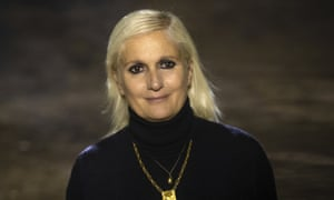 Designer Maria Grazia Chiuri acknowledges applause after her spring /summer 2020 collection for Christian Dior was unveiled at the Paris fashion week.