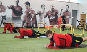 Jesse Lingard (left), Marcus Rashford and Victor Lindelöf get down to work at the Manchester United training ground.