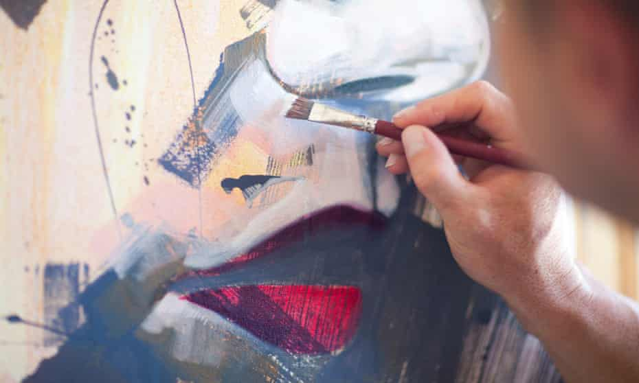 Close up of mature male artist working on canvas