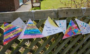 Messages to loved ones tied to the fence outside a nursing home during the coronavirus lockdown.