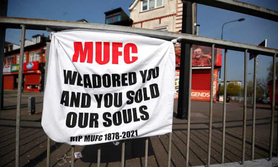 A banner left by Manchester United fans on Sir Matt Busby Way reading: 'MUFC We adored you and you sold our souls. RIP MUFC 1878-2021'