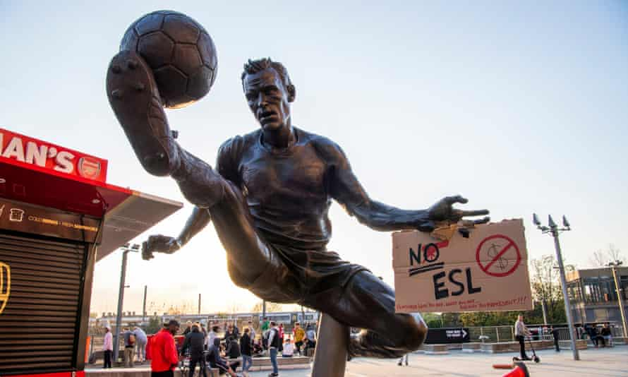 People gather in protest against the European Super League at the Emirates Stadium, London.