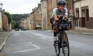Fiona Kolbinger rides through the village of Teillay in north-west France