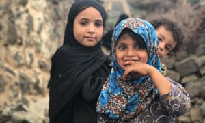 Displaced children wait at a UNHCR emergency aid distribution point in Yemen's Utmah district
